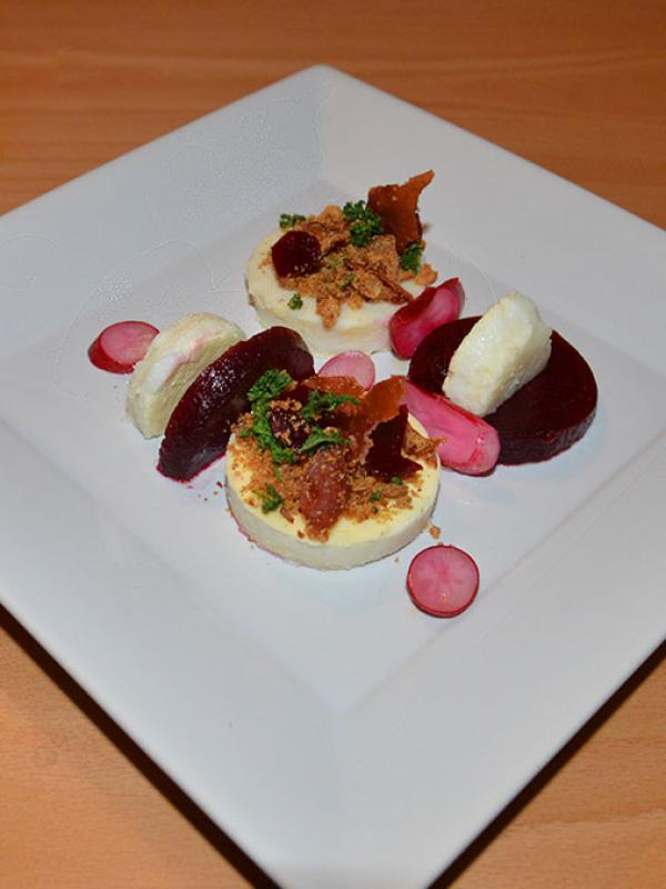 Cheese flan with crumble and sweet & sour vegetables