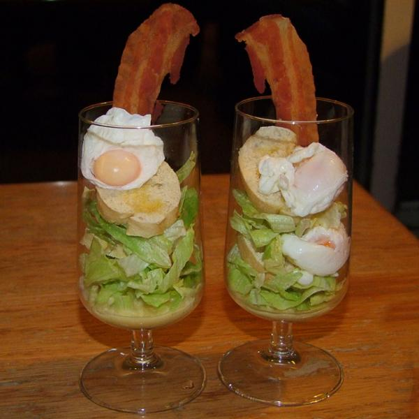 Salad with quail egg and bacon